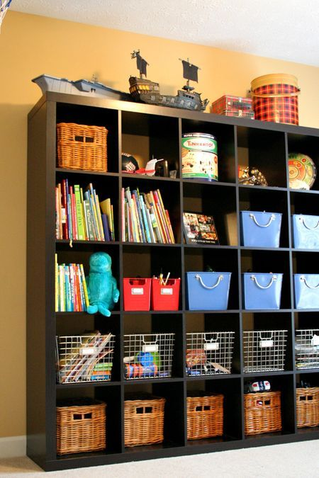 Great way to use the Expedit for storing kids toys, now where did she find those…