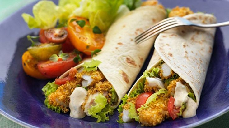 Fish fajita full of crispy strips of fresh cod in a tangy sour cream sauce tucked inside a toasty oven baked tortilla.
