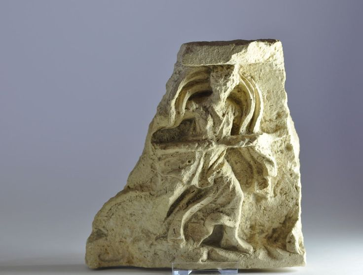 Greek frieze, Taras, Greek frieze fragment from a limestone frieze depicting dancing maenad with swirling drapery and holding thyrsus, 4th century B.C. 21 cm high. Private collection