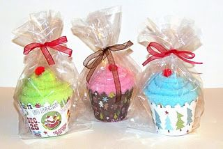 take fuzzy socks, roll them up, stick them in a cupcake holder and instant gift!