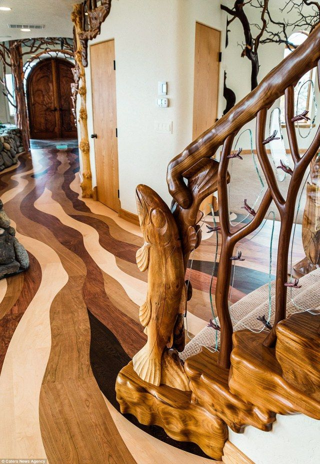 Whimsical property sits by an Oregon mountain range and features impressive interior tree sculptures