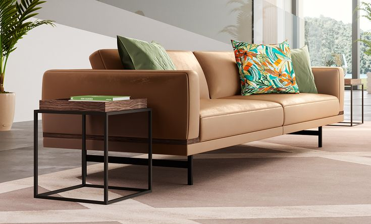 The brown tones of the sofa are matched with the wooden tones of the coffee table, for a cozy atmosphere, which is accentuated by the walnut detail.