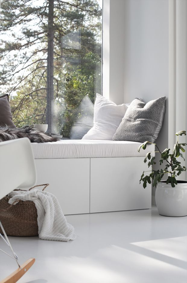 Small, modern window seat for you to curl up with a good book CabinetsDesigns.net