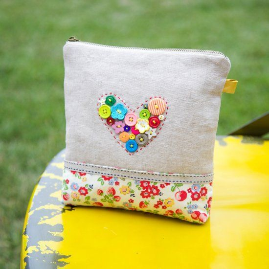 Gather your button jars and arrange as heart. You just finished the first step of the prettiest pouch making.