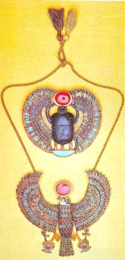 From the pictures I've seen of Egyptian jewelry, most of them seem to depict animals. The beetle in the top of this picture is very popular but I'm not quite sure why. Their colors were very vibrant and harmonious, standing out against their white attire.