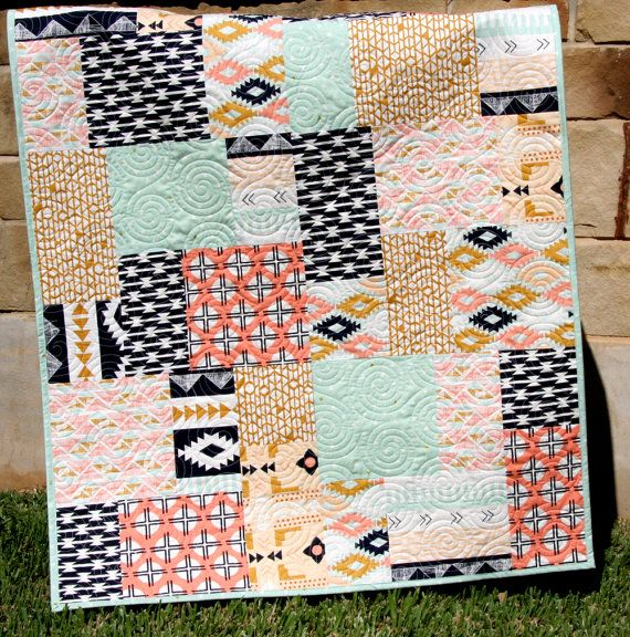 This quilt was made with Arizona by April Rhodes for Art Gallery Fabrics. This adorable quilt includes bold colors of coral, mint green, navy,