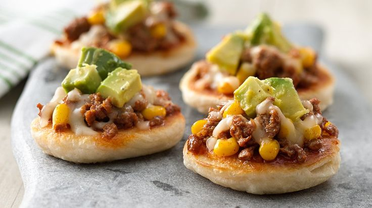 Mini Mexican Gorditas -  It's fiesta time! Grands! biscuits take on a cheesy-sausage mix with a fresh avocado topper.