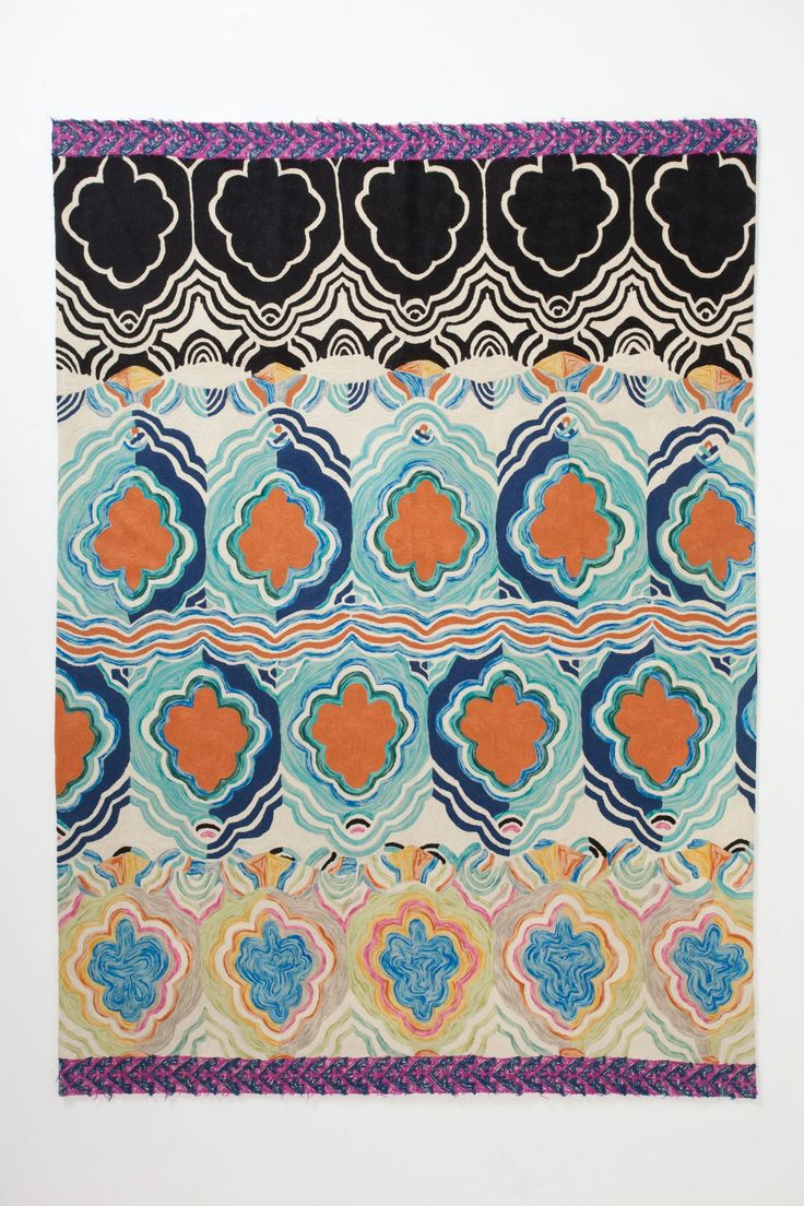 Blues and oranges are my favorite paired together. Tapa Crewelwork Rug - Anthropologie.com #Anthropologie #PinToWin