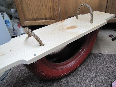 Old Tire becomes a new seesaw