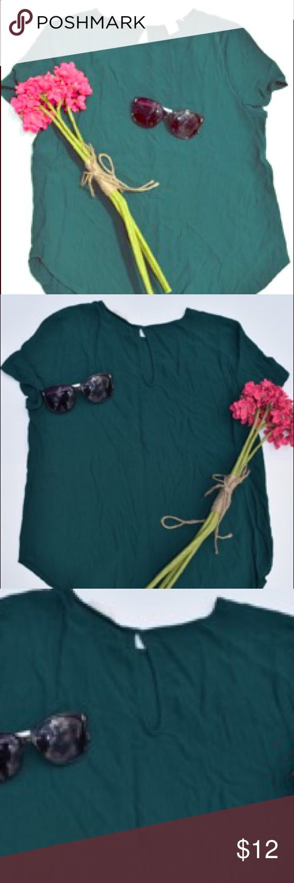 Green H&M TShirt Blouse 👚 Beautiful emerald green colored TShirt Blouse from H&M. Great shirt for year round. Cute peep hole in the back neckline. Great condition. Size 10 but fits like a M H&M Tops