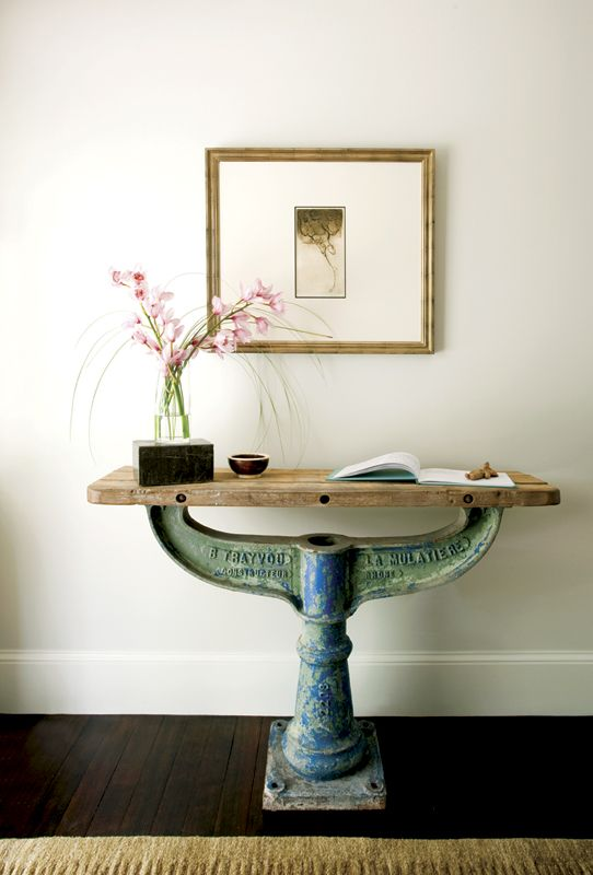 I love this repurposed table.  Old tractor and farming parts would make great repurposed parts for furniture.
