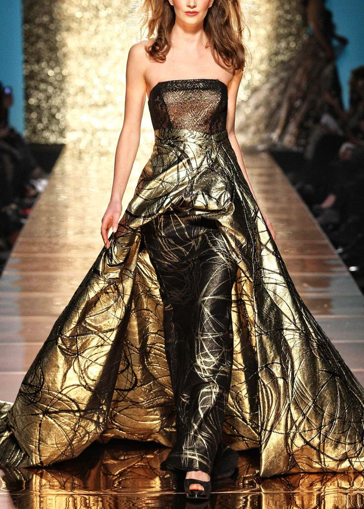 Addy van den K gold lame with black accents, sheer bodice  #gowns #fashion #style #design #hautecouture #couture