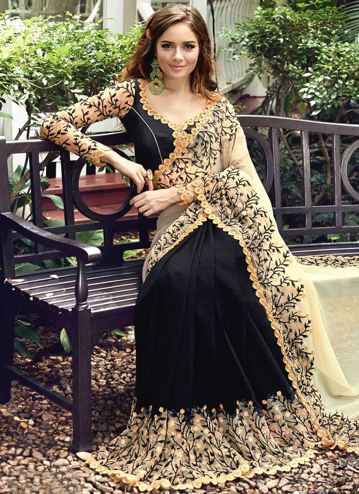 Buy sarees online at heustyle, a brand with huge collection of bridal sarees. Shop this charming black classic designer saree.