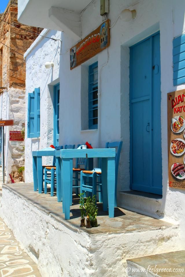 Traditional taverna with blue table and chairs in the heart of Kimolos Chorio