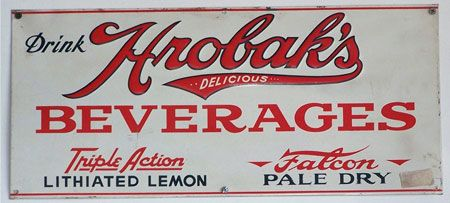 In the U.S., most outdoor signs made between 1890 and and 1950 were constructed of a base of heavy rolled iron, which was die cut into the desired shape, then coated with layers of colored powdered glass and fired in a kiln. This process made them durable and weather-resistant. Signs made this way were known as porcelain enamel signs or simply enamel signs.     Porcelain enamel signs originated in Germany and were imported into the U.S. They quickly became a staple of outdoor advertising…