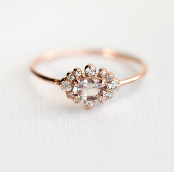 Peach sapphire ring with a halo of diamonds