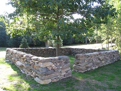 I want to build a fence like this...maybe my boys will go around the neighborhood and find the rocks for me :-)