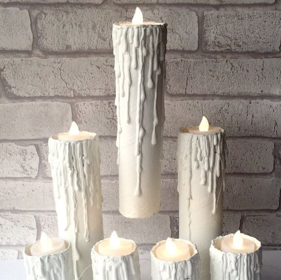 Have you always admired the floating candles that adorn the ceiling of the Great Hall in Hogwarts? Now that can be a reality in your own home!  This listing is for seven floating candles, four small and three large.  Large candle: approximately 23cm or 9 inches. Small candle: approximately 13cm or 4.7 inches.  There are two options with tealights. We can send you battery powered LED lights to go in the candles - for this option select With tealights. If you would rather provide your own…