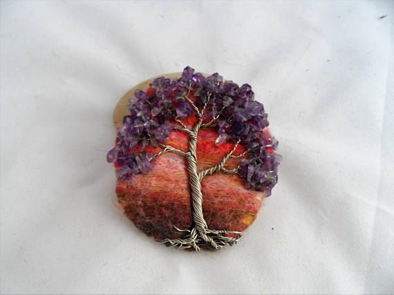 Check out this item in my Etsy shop https://www.etsy.com/uk/listing/524657523/needle-felt-wire-wrapped-amethyst-gem
