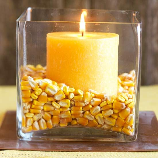 Dried corn kernels make a great centerpiece! Find more natural ideas here:  http://www.bhg.com/halloween/decorating/creative-fall-centerpieces-featuring-natural-elements/?socsrc=bhgpin091414cornandcandlescenterpiece&page=12