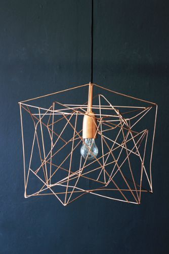 Asymetric Shiny Copper Lampshade  Anthropologie and other loft spaces have featured similar. Again, could hang in multiples for greater effect