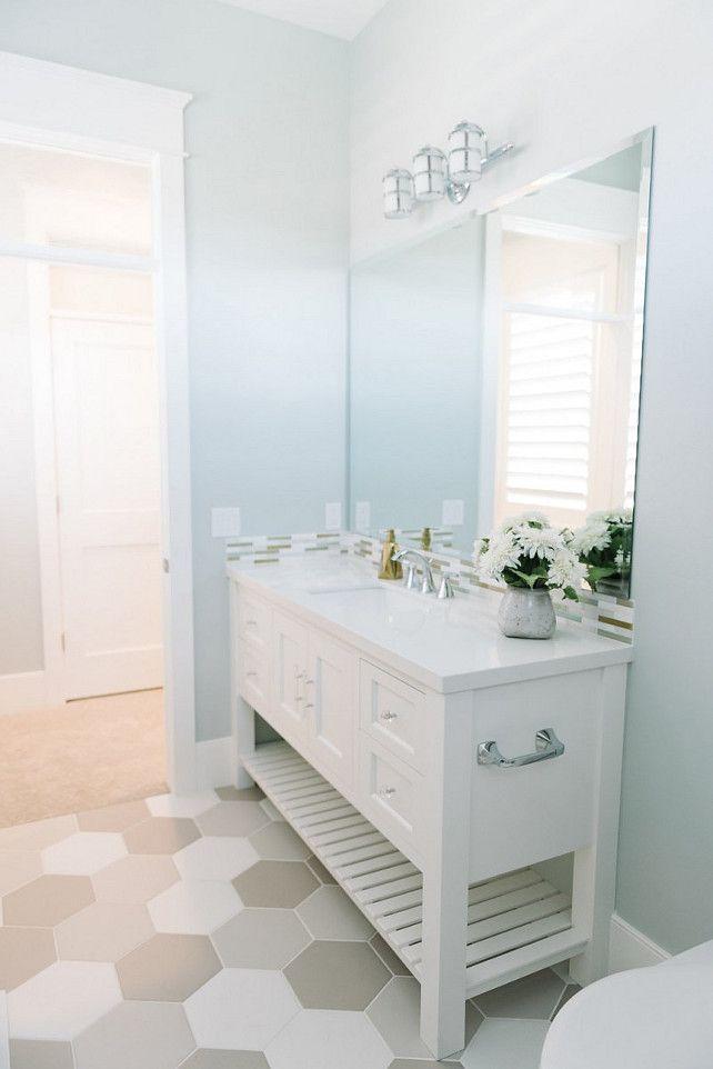 Bathroom. Light blue bathroom with large hex floor tiles. #hexbfloortile Millhaven Homes.