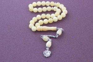 http://www.toptantesbih.net/damla-kehribar-tesbih/ Damla kehribar tesbih açık sarı gümüş püsküllü 33 taşlı model