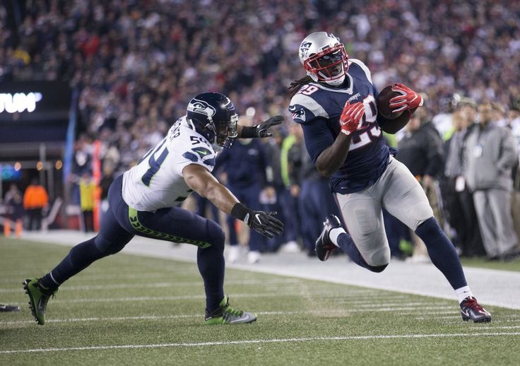 Seahawks vs. Patriots:  31-24, Seahawks  -  November 10, 2016  -   New England Patriots running back LeGarrette Blount (29) scores a touchdown after Seattle Seahawks linebacker Bobby Wagner (54) dives for but failed to make the tackle during the third quarter. (Dean Rutz / The Seattle Times)