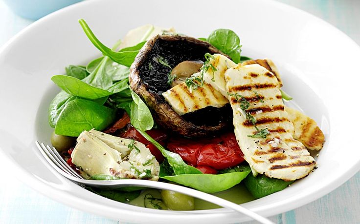 Serve up a healthy, tasty lunch with this vegetarian dish. Enjoy the barbecued vegetables and salty slices of haloumi combined with a fresh and zesty lemon basil dressing. Recipe by the Australian Women's Weekly.