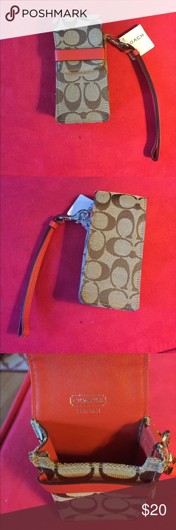 BRAND NEW COACH CELL PHONE CARRIER  FITS IPHONE6 NWT coach phone carrier. Fits an iPhone 6. Orange and light brown. Coach Bags Clutches & Wristlets