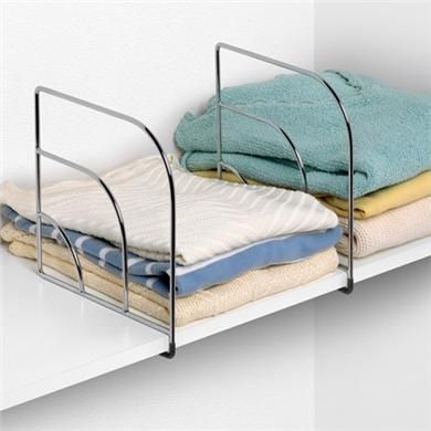 Use shelf dividers to organize folded clothes like sweaters, t-shirts and jeans in a small closet in your apartment, freeing up valuable hanging space for the stuff that is prone to wrinkles.