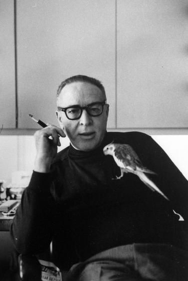 "Dalton Trumbo sits at his desk with his pet bird. He wrote many famous screenplays under many aliases as he was blackballed during the Hollywood Ten incident.  As one of the Hollywood Ten, he refused to testify before the House Un-American Activities Committee (HUAC) in 1947 during the committee's investigation of Communist influences in the motion picture industry. Trumbo won two Academy Awards while blacklisted; one was originally given to a front writer, and one was awarded to ""Robert…"