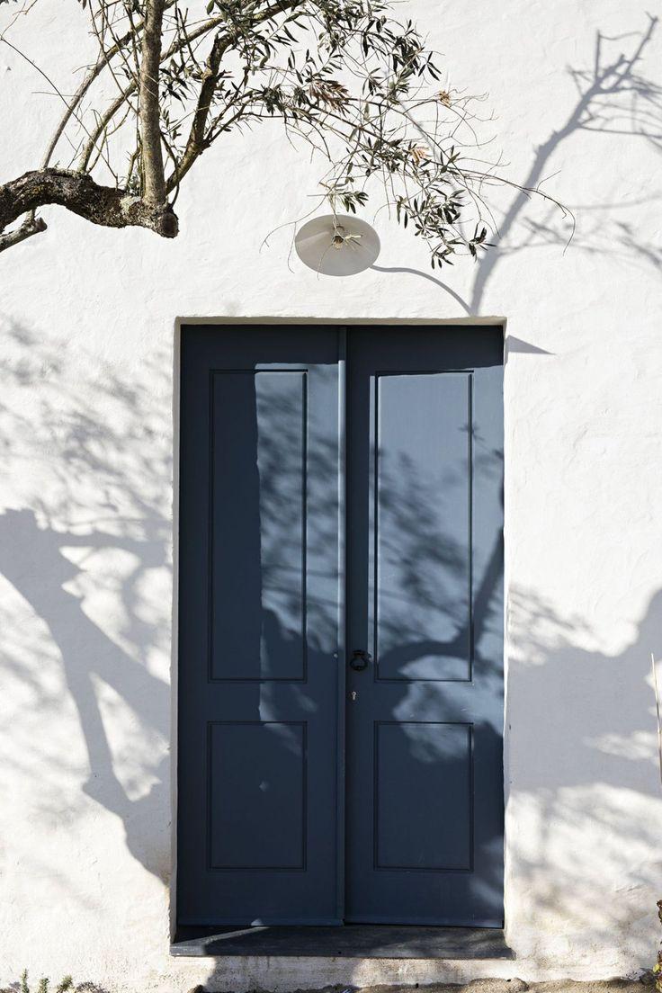 Blue door at são lourenço do barrocal a model for modern rural living photography