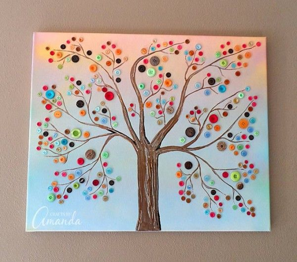 Make this beautiful button tree for your home. This button tree tutorial shows you step by step how to turn an ordinary canvas into colorful wall art! - by Amanda Formaro of Crafts by Amanda
