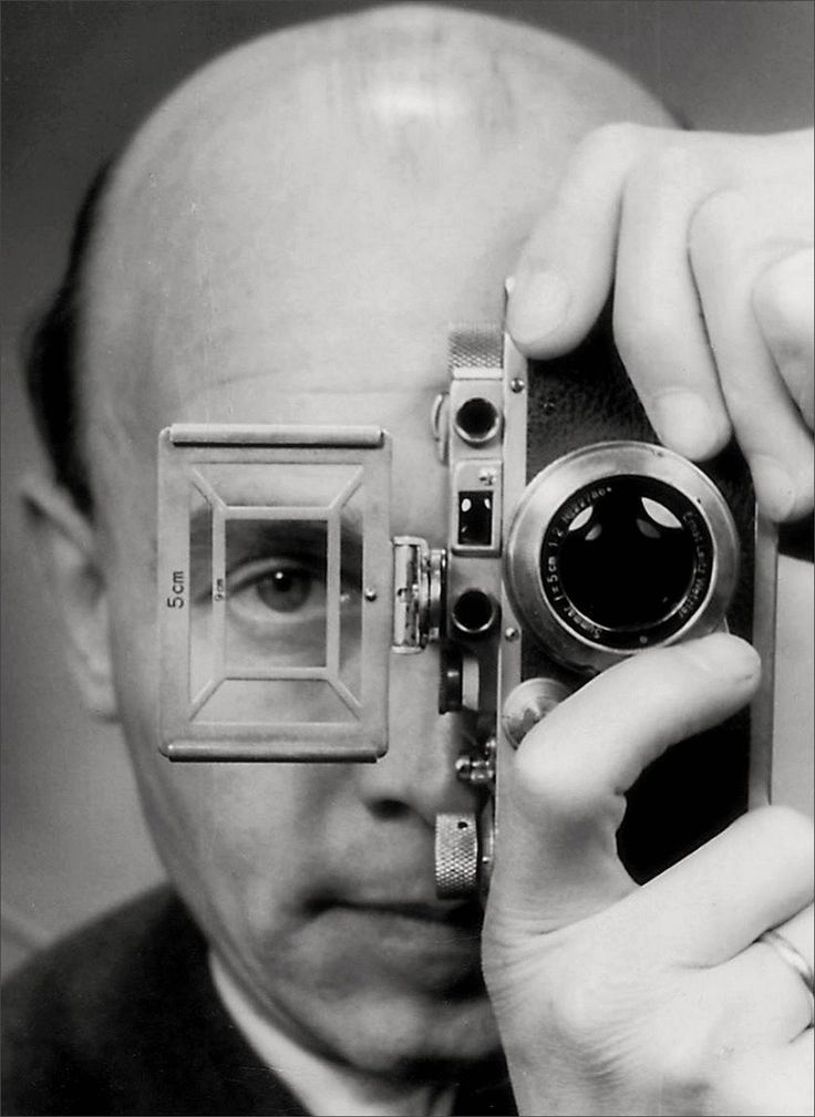 Otto Umbehr · Self Portrait with Leica | Self-timer · 1952