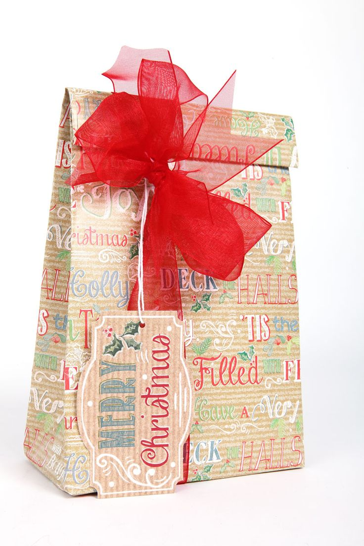 Make your own gift bags! This bag has been produced using RW95 Christmas Quotes roll wrap featuring XGT57, the matching gift tag, and tied with red organza ribbon