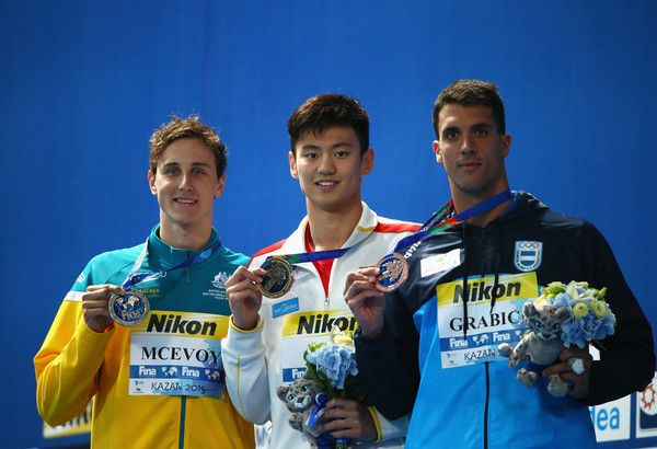 .Gold medalist Zetao Ning (C) of China poses with silver medalist Cameron McEvoy (L) of Australia and bronze medalist Federico Grabich (R) of Argentina during the medal ceremony for the Men's 100m Freestyle on day thirteen of the 16th FINA World Championships at the Kazan Arena on August 6, 2015 in Kazan, Russia.