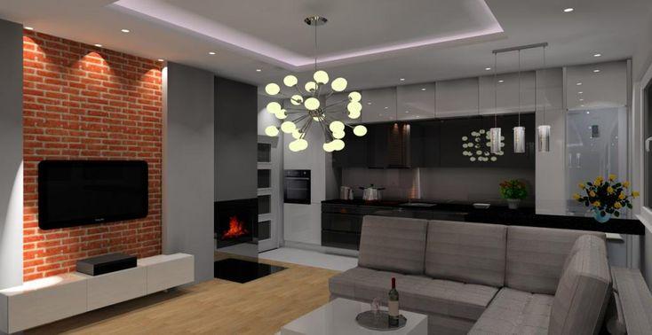 Salon z aneksem kuchennym w kolorze czarny, szary, biały, cegła czerwona na ścianie z TV, kominek, barek