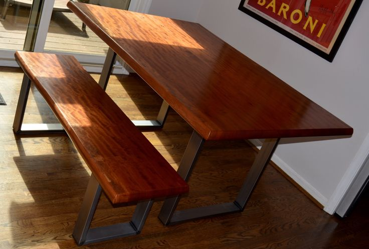 """MAKORE TABLE AND BENCH: Made from a single 2"""" thick slab, this live edge seating set rests upon sturdy welded metal legs. Exceptional chatoyance in the woodgrain makes the surface resemble a reflector, shifting light and dark grain patterns as you move across the room. Table is 30"""" tall x 42"""" wide x 60"""" long. Bench is 18"""" tall x 16"""" deep x 54"""" long."""