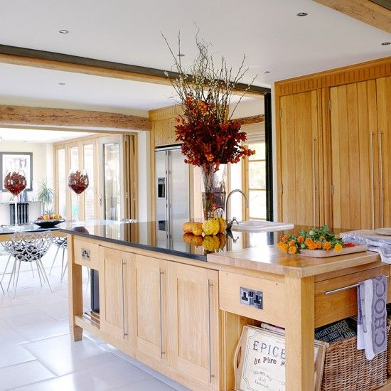 Contemporary kitchen with wooden cabinetry