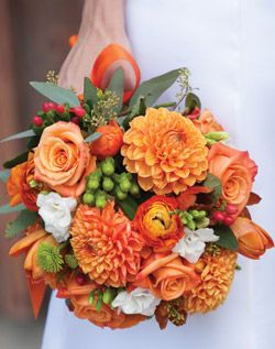 Orange Wedding Bouquet I really like the use of greenery in this one. and Love me some mums