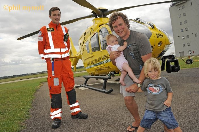 Professional photographer, Phil Mynott took this press photo of crash survivor Mark Warren who dropped in to Cambridge Airport to say thanks to the East Anglian Air Ambulance crew who airlifted him to hospital one year ago.