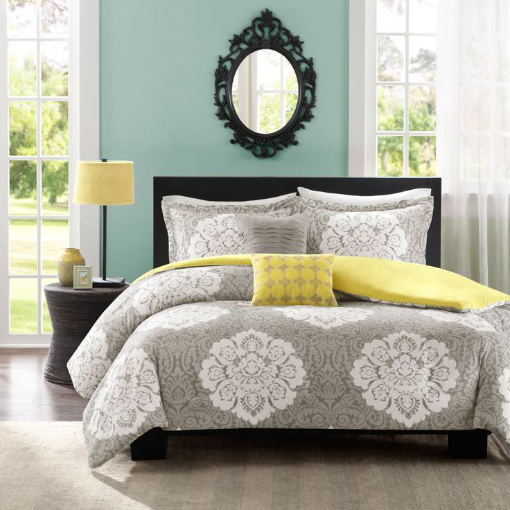 Update your space with style and comfort. The Intelligent Design Ciara Duvet Cover Set combines a modern grey with a soft yellow reverse to highlight this beautiful white damask print.