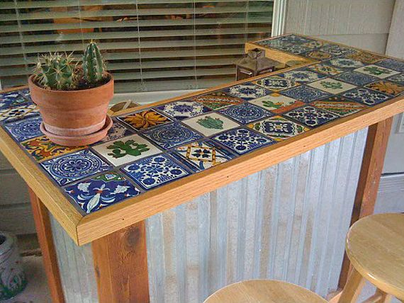 10 DIY Outdoor Bars! ~ With outdoor spaces being extensions of the indoors in today's homes, making a DIY bar just seems like a dang good idea. And if you don't prefer to serve alcohol, use your DIY bar to serve the best iced tea around!  ~ #1. Our featured photo, is a tiled outdoor bar. It has a full tutorial, with step by step drawings. What a great style for a mediterranean or exotic feel to your garden! I love the corrugated metal, it keeps this project looking updated.