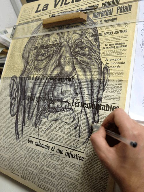 Mark Powell Niro drawing on antique documents