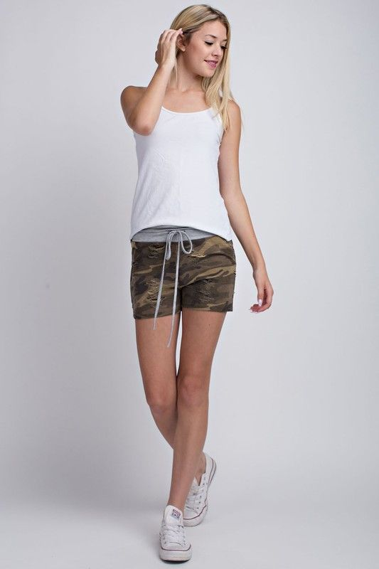 Distressed Perfect Camouflage shorts with distressed/ ripped segments and under lining.
