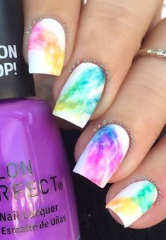 If you're trying the rainbow nail art design but you want it in a subtle way…