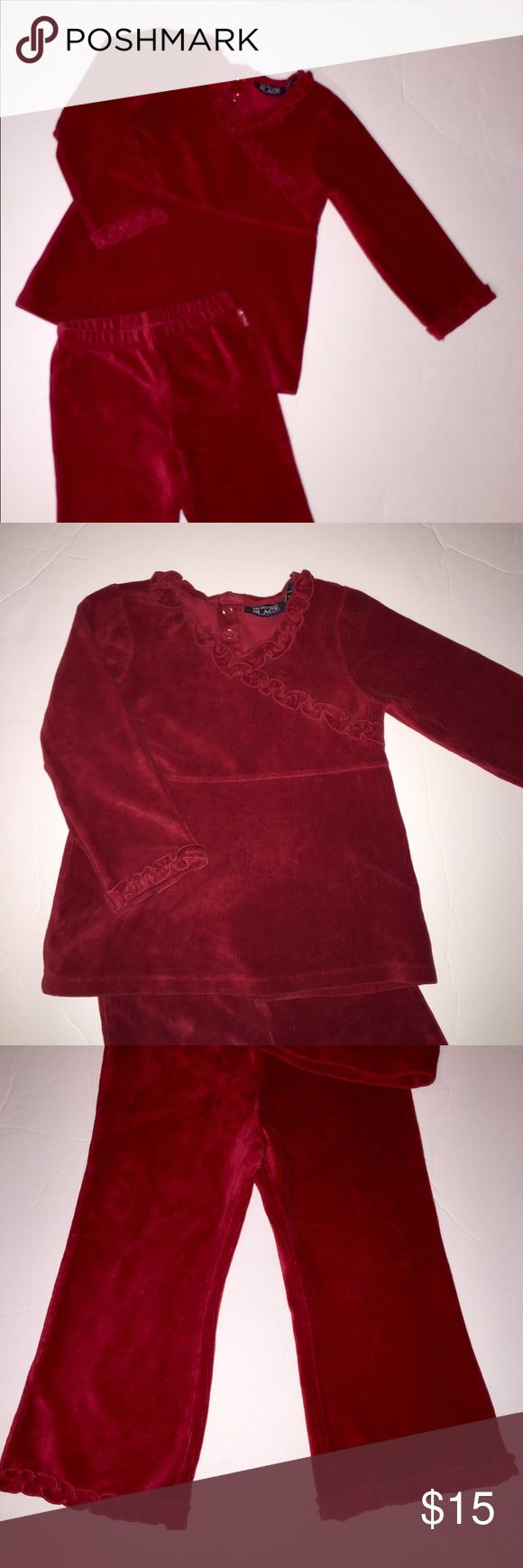 Children's Place Ruffle Red Velour Outfit size 3T Adorable Holiday Outfit size 3T by Children's Place. Velour Outfit with ruffles on sleeve ends and around V-Neck. 2 Snap Closure at top of Back for easy on and easy off. Pull-on Pants with Ruffle bottoms of pants. Super cute and hard to tell w/photographs. Children's Place Matching Sets