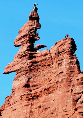 Climber atop Corkscrew Summit, Ancient Art Tower at Fisher ...