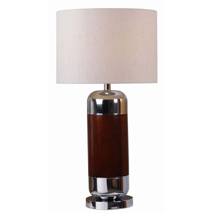 Add a retro touch to any space with the vintage inspired Alton table lamp. Displaying an impressive mahogany finish, this unique piece features an oatmeal drum shade that tops the lamp while accenting its darker and light finishes.